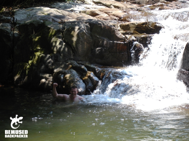 Getting a natural shower under a waterfall