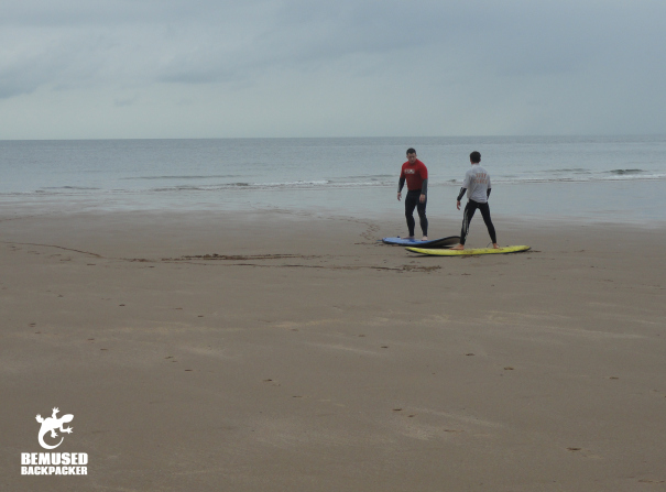 Learning to surf Caswell Bay Wales