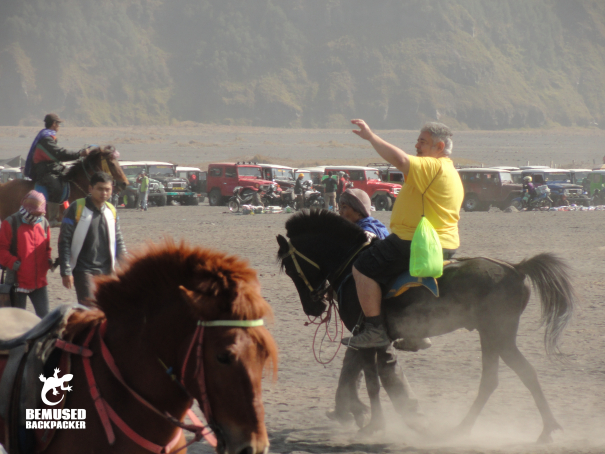 Responsible tourism riding horses sea of sand Mount Bromo Indonesia
