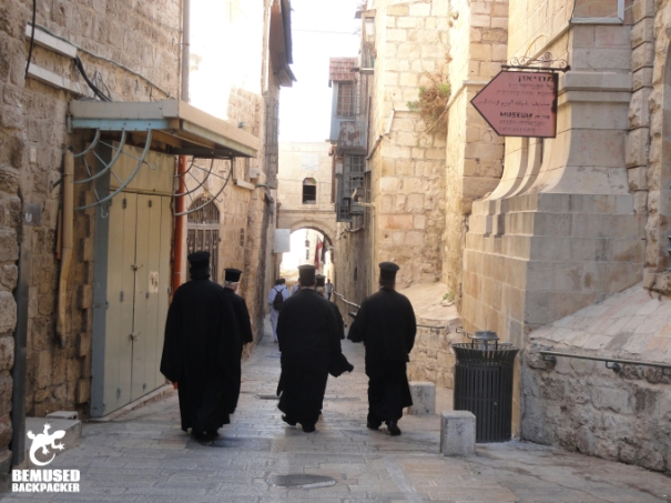 Priests walking through the old city of Jerusalem Israel