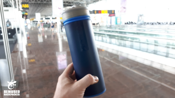 using GRAYL water bottle at an airport