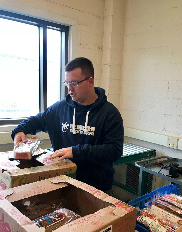 Michael Huxley New York volunteering food bank