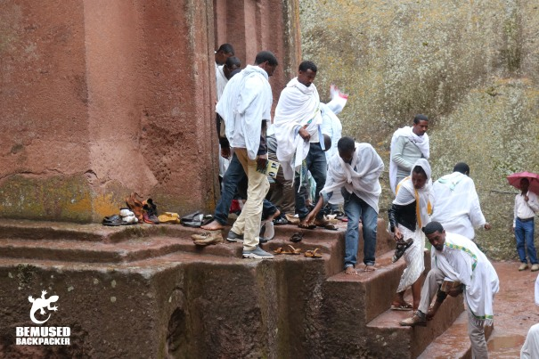 rock hewn churches of lalibela ethiopia locals taking off shoes outside of church